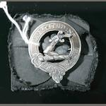 A silver plaid brooch for clan Ross