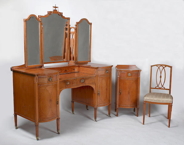 An Edwardian satinwood and inlaid bedroom suite by Gillows,