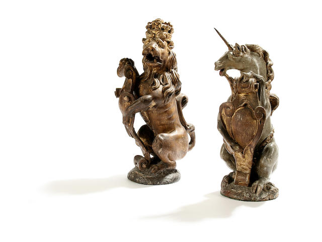 A rare pair of late 17th Century painted and carved oak figures of a lion and unicorn, English