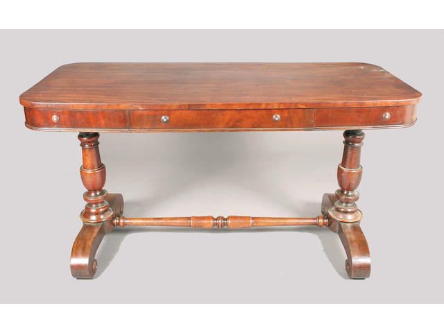 An early Victorian mahogany library stretcher table,
