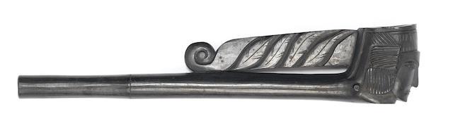 A Haida argillite effigy clay pipe type 20cm.