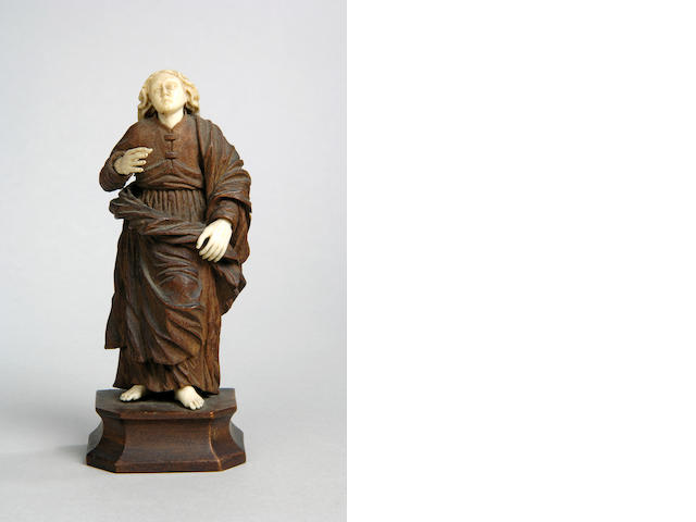 A 19th Century carved boxwood and ivory figure of a saint