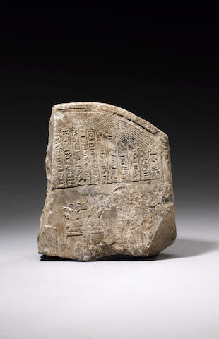 An Egyptian limestone funerary stele fragment