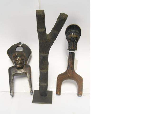 Three miniature West African artefacts mounted, 22cm. high. 3