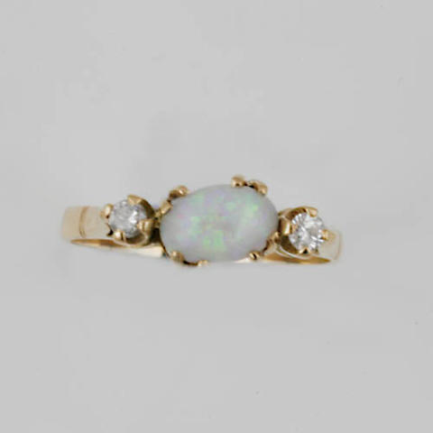A pair of opal and diamond earclips,