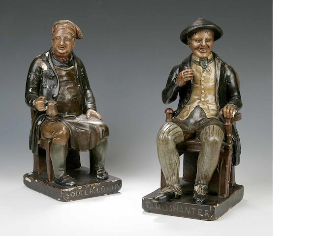 A pair of titled polychrome plaster figures,