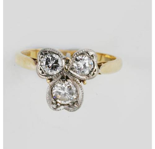 A diamond cloverleaf ring,