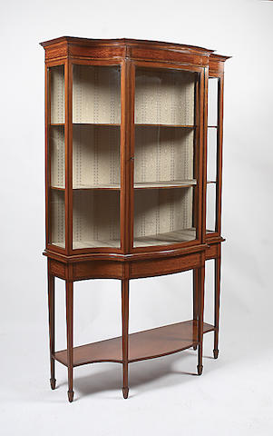 An Edwardian satinwood banded and ebony strung display cabinet