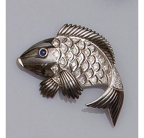 A diamond set fish brooch,