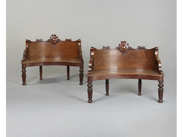 A pair of Victorian bow shaped mahogany window seats