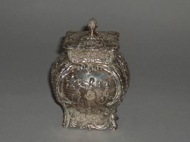 A 19th Century Dutch silver embossed tea caddy, import marks for London 1896,