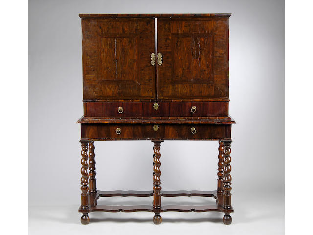 A late 17th Century/early 18th Century laburnam and oyster veneered cabinet on stand