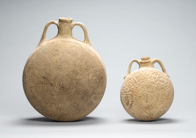 Two unglazed pottery Flasks (2)