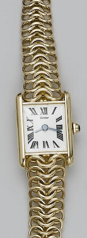 Cartier/ Jaeger le Coultre. A lady's 18ct gold wristwatch in presentation caseTank, 1950's