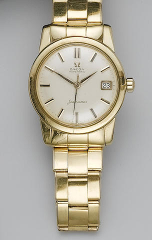 Omega. An 18ct gold calendar bracelet watch Seamaster, London import mark for 1960
