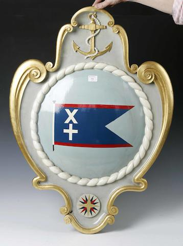 A polychrome painted and gilded wall plaque shield displaying The Currie Line house flag