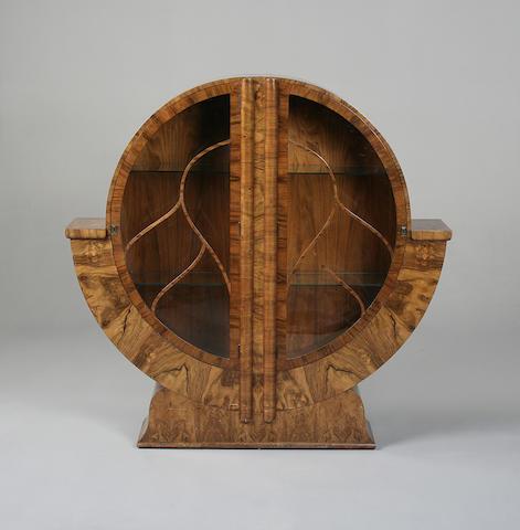 An Art Deco wlanut circular display cabinet
