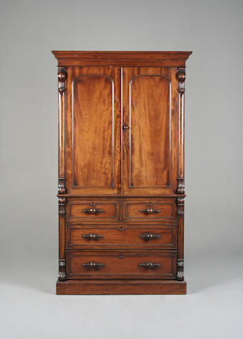 A Victorian carved mahogany linen press