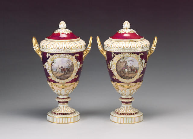 A pair of KPM Berlin two handled vases and covers, circa 1880