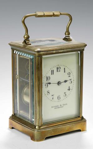 An early 20th century brass carriage clock retailed by RITCHIE & SONS, EDINBURGH