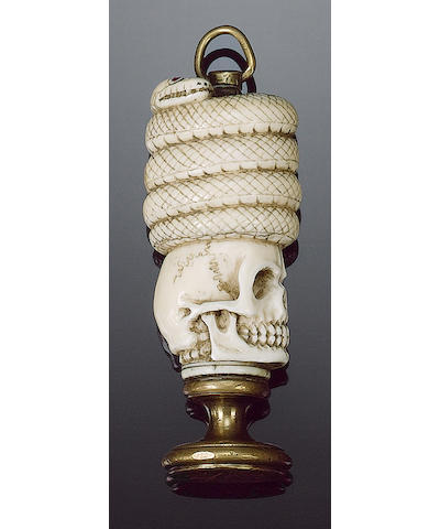A 19th century ivory and brass mounted occult seal