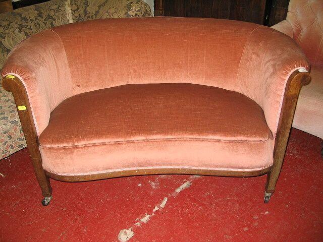 A pair of Edwardian mahogany framed kidney shaped sofa's