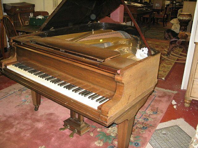 A mahogany cased Chappell baby grand piano
