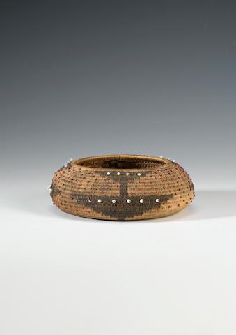 A Pomo coiled basket 15cm. diam. x 5cm. high.