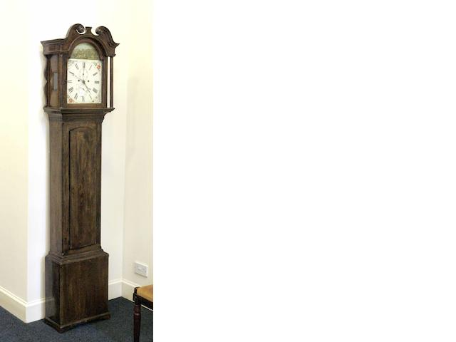 An early 19th century mahogany and inlaid longcase clock