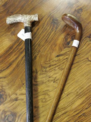 An early 20th century golf club walking stick and a gilt presentation walking stick
