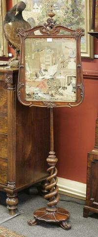 A Victorian rosewood fire screen