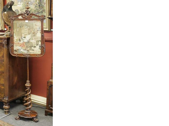 A Victorian rosewood fire screen
