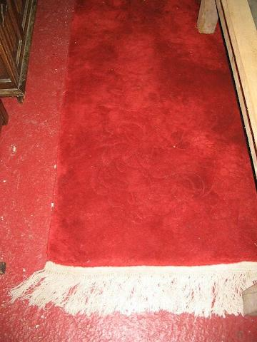 A large 20th Century Chinese red rug