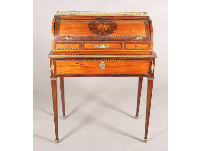 A 19th century Louis XVI style tulipwood, mahogany and stained fruitwood veneered and gilt metal mounted secretaire a cylindre