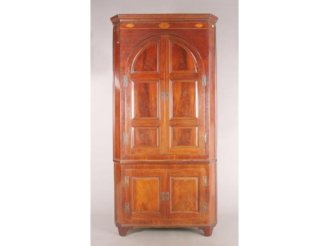 A George III inlaid mahogany floorstanding corner cupboard