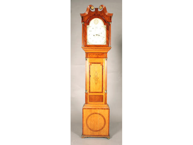 An early 19th century oak and mahogany crossbanded longcase clock