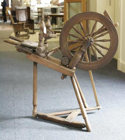 A beech and stained pine spinning wheel