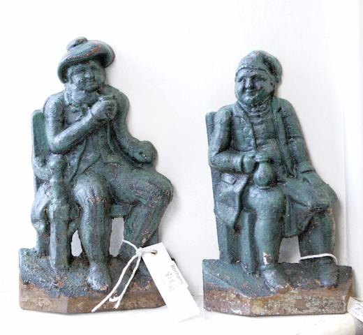 A pair of painted cast iron door stops depicting Tam O'Shanter and Souter Johnny