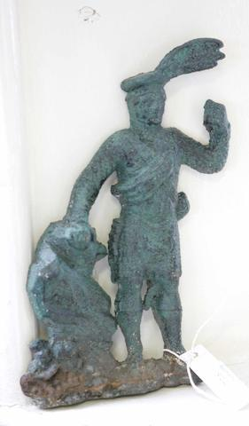 A cast iron doorstop modelled as a figure of a kilted Scotsman