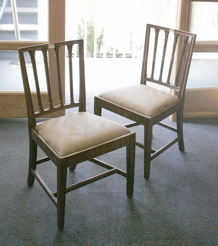 A set of four George III mahogany brander back dining chairs,