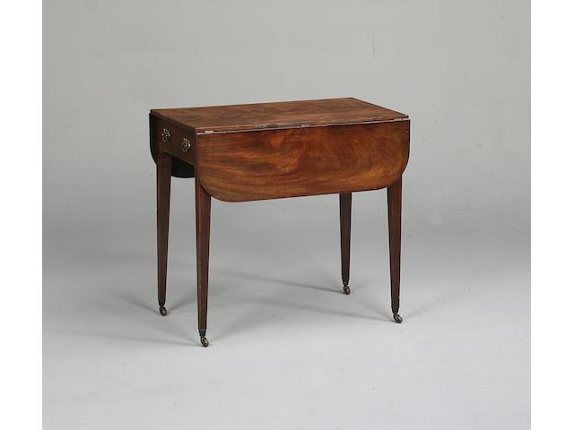 A George III mahogany Pembroke table, 75cm wide x 86cm deep x 71cm high.