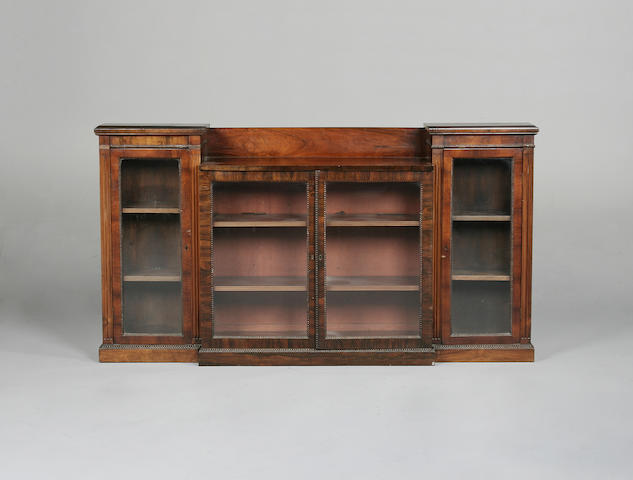A rosewood breakfront bookcase/display cabinet