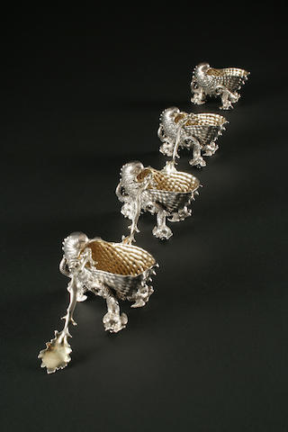 A matched set of four Victorian cast salts and three spoons two by Paul Storr, two by John Samuel Hunt, London 1839,