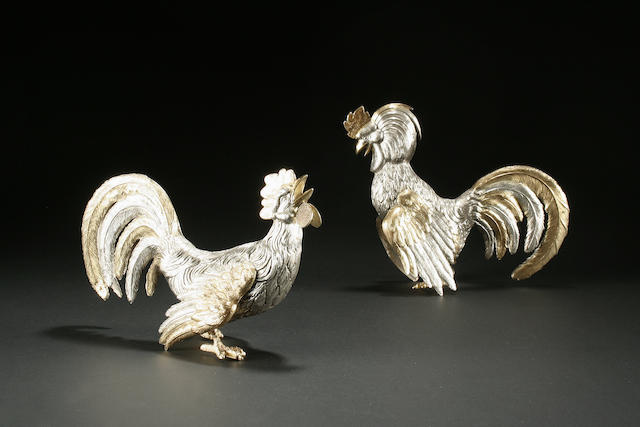 A pair of Continental silver-gilt and silver fighting cocks bears control marks