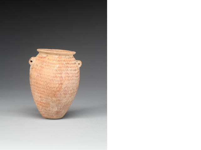 An Egyptian Pre-Dynastic lug-handled pottery jar