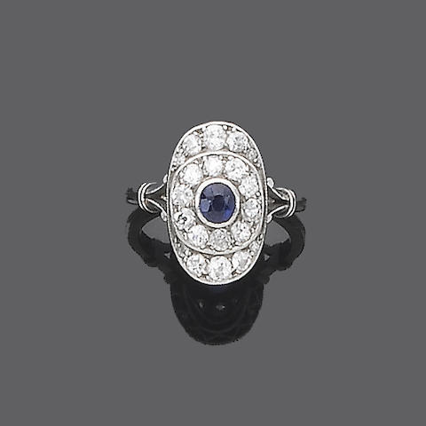 An early 20th century sapphire and diamond cluster ring,