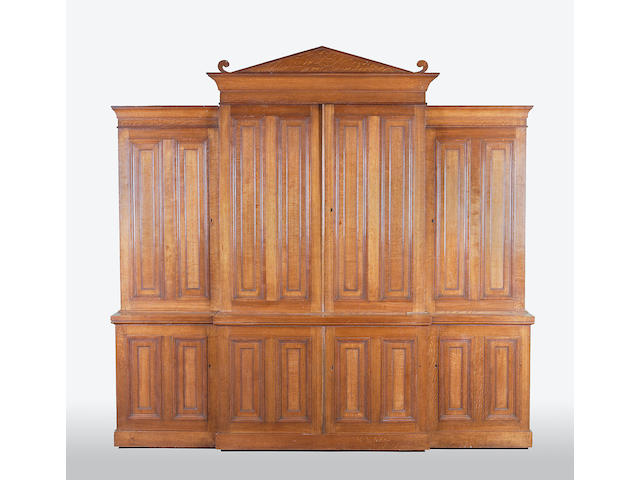 A mid Victorian oak breakfront cabinet bookcase of architectural form