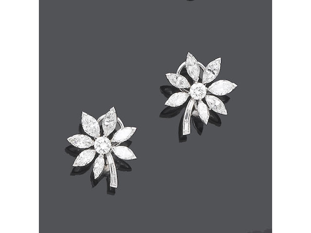 A pair of diamond earclips
