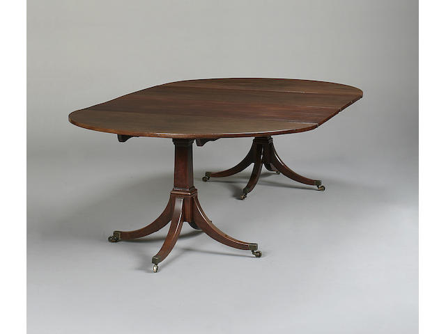 A 19th century mahogany twin pillar dining table