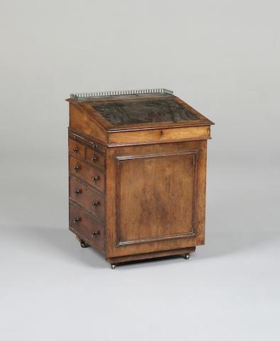 A mid Victorian walnut davenport